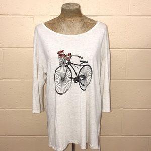 Tan& cream top with bike.